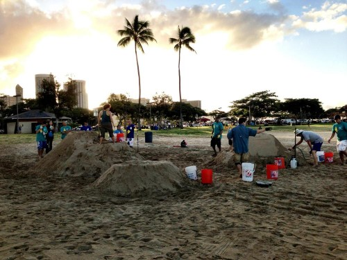 At Ala Moana Beach Park, Alex & Nick prepare to make sand sculptures with the Sand Guys!