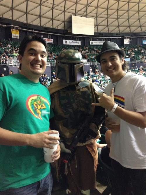 "After singing the national anthem, Alex & Nick pose with ""Boba Fett,"" a character from the movie ""Star Wars."""