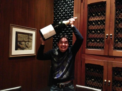 Holding a huge bottle of champagne, Nick shows off his recent vacation in Napa Valley!